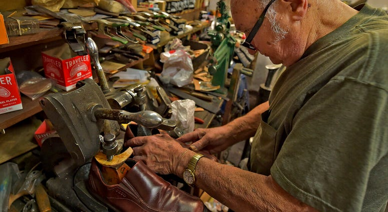 Tony Bonczewski repairs a heel on a customer's shoe at his cobbler shop in Wilkes-Barre, Pa.