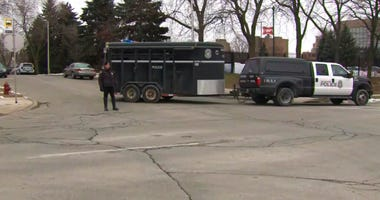 This image provided by WISN-TV, police respond to a possible shooting at the MillerCoors campus in Milwaukee on Wednesday, Feb. 26, 2020.