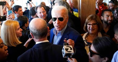 Democratic presidential candidate former Vice President Joe Biden greets customers at the Buttercup Diner during a campaign stop in Oakland, Calif., Tuesday, March 3, 2020.