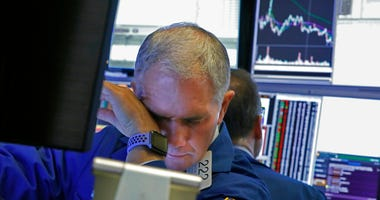 Specialist Timothy Nick works on the floor of the New York Stock Exchange,