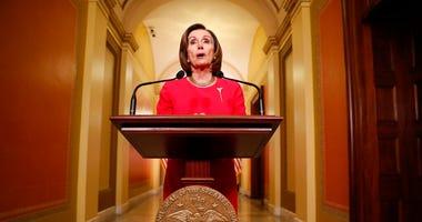 House Speaker Nancy Pelosi of Calif. speaks outside her office on Capitol Hill, Monday, March 23, 2020.