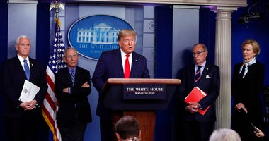 President Donald Trump speaks about the coronavirus in the James Brady Briefing Room, Tuesday, March 24, 2020, in Washington, as Vice President Mike Pence, Dr. Anthony Fauci, director of the National Institute of Allergy and Infectious Diseases, Larry Kud