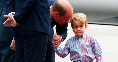 Britain's Prince William and his son Prince George