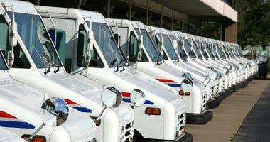 Line of USPS trucks