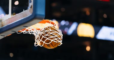 A basketball player makes a basket