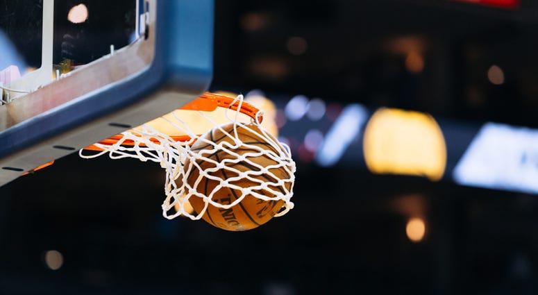 A basketball player makes a basket