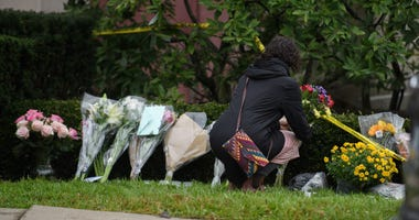 A visitor lays flowers at the site of the mass shooting that killed 11 people and wounded 6 at the Tree Of Life Synagogue in Pittsburgh.