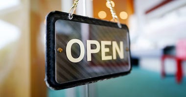 Open Sign Hangs in Business Window