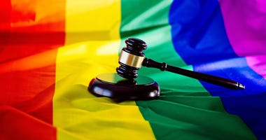 Pride flag with a gavel