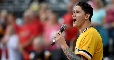 Steven Brault #43 of the Pittsburgh Pirates sings the national anthem before the game against the St. Louis Cardinals