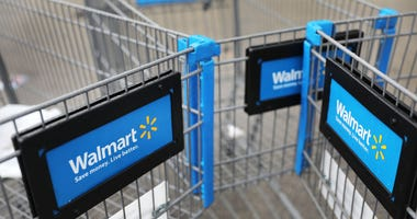 Walmart carts are seen outside of a store