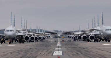 Jets are parked on a runway at the Pittsburgh International Airport in Pittsburgh, Pennsylvania. Due to decreased flights as a result of the coronavirus (COVID-19) pandemic, planes are being stacked and parked at the airport.