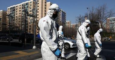 South Korean disinfecting crews