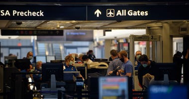 Travelers make their way through ticketing and TSA inspection at Pittsburgh International Airport