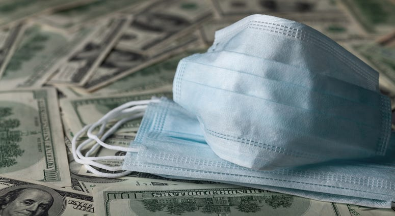 edical face mask and dollar banknotes, world coronavirus epidemic and economic losses concept