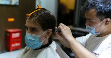 Cutting hair with masks on