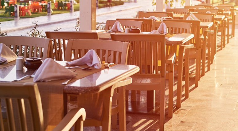 Empty terrace with a table and chairs outdoor in sunset