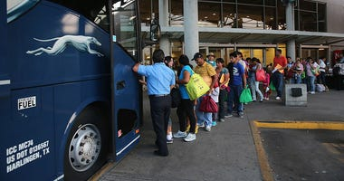 Central American travelers boarding a Greyhound bus