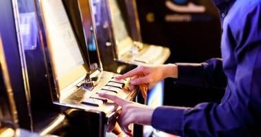 Man playing a slot machine