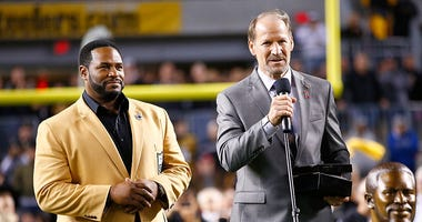 erome Bettis is introduced by Bill Cowher during the presentation of his Hall of Fame ring at halftime of the game between the Pittsburgh Steelers and Baltimore Ravens at Heinz Field