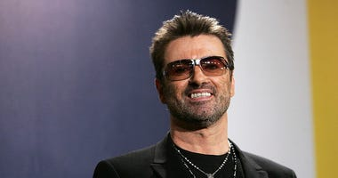 """BERLIN - FEBRUARY 16: Singer George Michael poses at the """"George Michael: A Different Story"""" Photocall during the 55th annual Berlinale International Film Festival on February 16, 2005 in Berlin, Germany."""