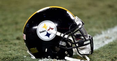 A Pittsburgh Steelers helmet sits on the field during the game against the Kansas City Chiefs in the AFC Divisional Playoff game at Arrowhead Stadium on January 15, 2017 in Kansas City, Missouri.