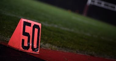 The fifty yard line marker after a high school football game