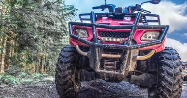 red quad bike in the forest, close-up, front view