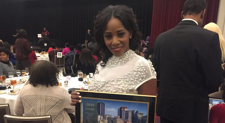 Timira Rush with her Women of Excellence Award