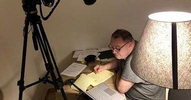 Jim Van Sickle writing a letter to the Pope last night that was delivered to the pontiff