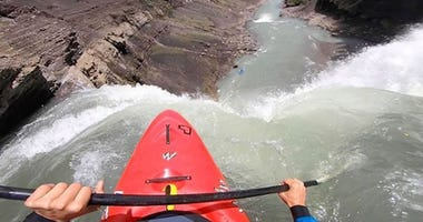 Kayaker Plunges Off 100-Foot Waterfall, Escapes with One Paddle and One Heck of a Video