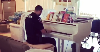 Police Officer's Hidden Musical Talent Brings Comfort to Family