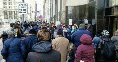 Several dozen demonstrators took to the street in front of U.S. Senator Pat Toomey's office to urge him to vote to end the partial federal government shutdown.