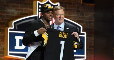 Roger Goodell and Devin Bush