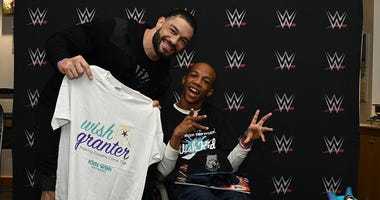WWE superstar Roman Reigns snags a photo with his biggest fan, Markel Smith at the FedExForum in Memphis.