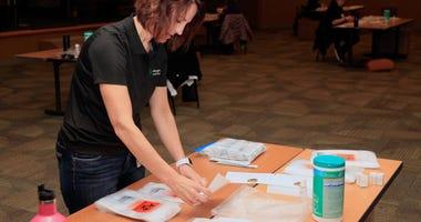 Volunteer assembled a coronavirus test kit for Allegheny Health Network