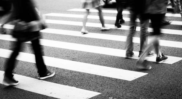 People Walking Through Intersection