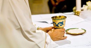 Priest at Church