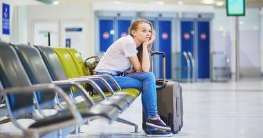 Woman waiting at airport