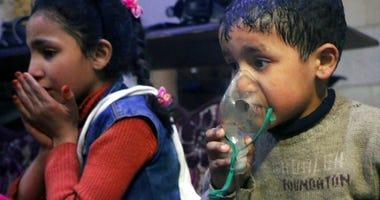Child receiving oxygen through respirators