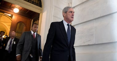 Former FBI Director Robert Mueller, front, the special counsel probing Russian interference in the 2016 U.S. election, leaves the Capitol building after meeting with the Senate Judiciary Committee on Capitol Hill on June 21, 2017, in Washington, D.C.