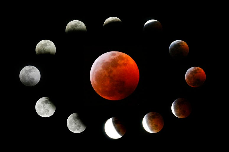 The totally eclipsed moon, center, and others at the different stages during a total lunar eclipse