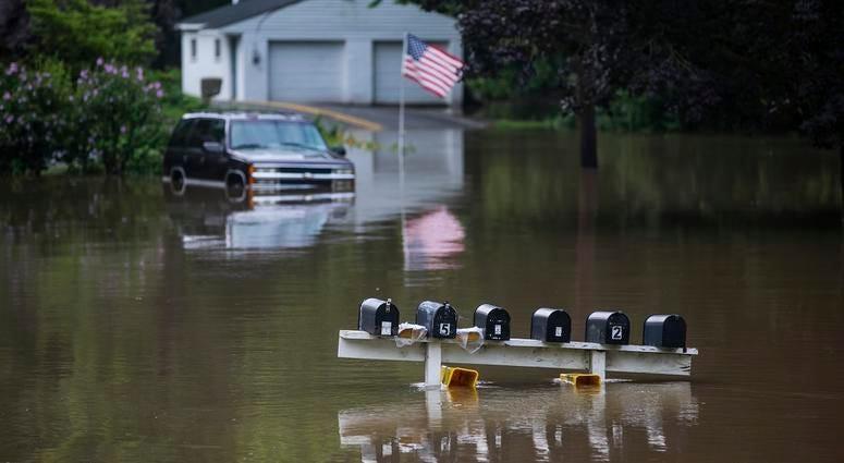 Water rises on Duke Street in Hummelstown, Pa.