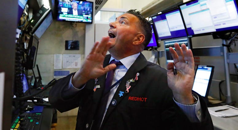 Trader Jonathan Muller works in his booth on the floor of the New York Stock Exchange, Monday, July 1, 2019. Stocks are rallying early Monday after the U.S. and China agreed to resume trade talks.