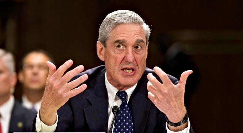 then-FBI Director Robert Mueller testifies on Capitol Hill in Washington