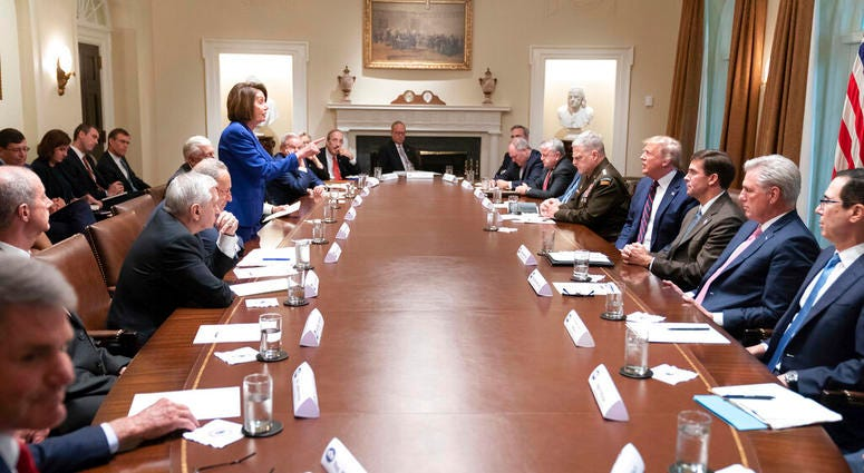 President Donald Trump, center right, meets with House Speaker Nancy Pelosi, standing left, Congressional leadership and others, Wednesday, Oct. 16, 2019, in the Cabinet Room of the White House in Washington.