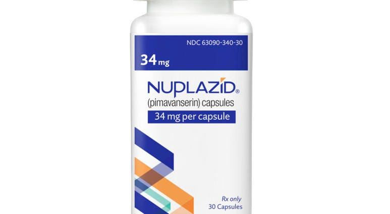 Acadia Pharmaceuticals Inc. shows a bottle of Nuplazid