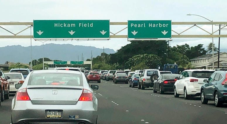 Traffic backs up at the main gates after a shooting at Pearl Harbor Naval shipyard, Wednesday, Dec. 4, 2019, near Pearl Harbor in Honolulu.