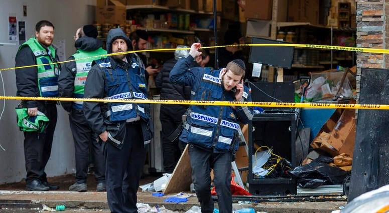 Responders work to clean up the scene of Tuesday's shooting that left multiple people dead at a kosher market on Wednesday Dec. 11, 2019, in Jersey City, N.J.