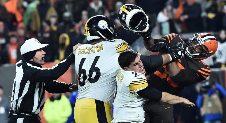 Cleveland Browns defensive end Myles Garrett (95) hits Pittsburgh Steelers quarterback Mason Rudolph